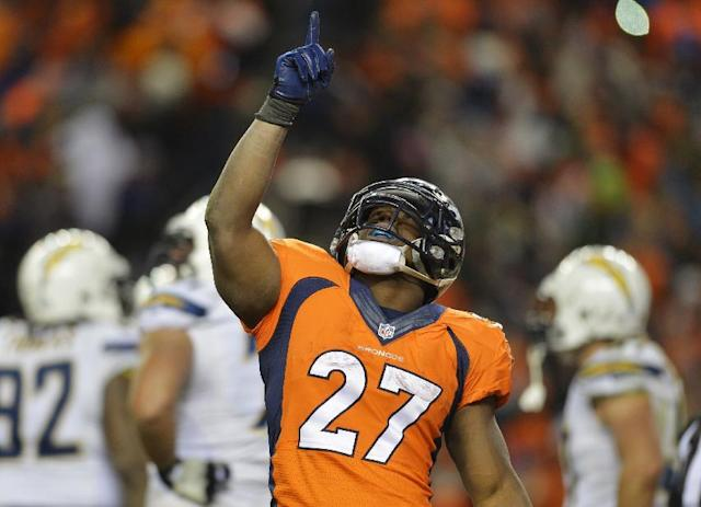 Denver Broncos running back Knowshon Moreno reacts after scoring a touchdown on a three-year run against the San Diego Chargers in the fourth quarter of an NFL AFC division playoff football game, Sunday, Jan. 12, 2014, in Denver. (AP Photo/Jack Dempsey)