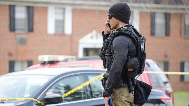 PHOTO: Law enforcement personnel work at the scene of a shooting, Wednesday, Feb. 12, 2020, in Baltimore. Two law enforcement officers with a fugitive task force were injured and a suspect died in the shooting, the U.S. Marshals Service said. (Ulysses Munoz/The Baltimore Sun via AP)