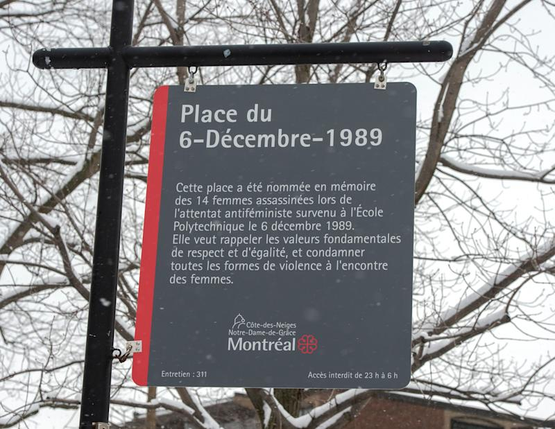 A new sign was unveiled at Dec. 6th Park in Montreal. The new sign now mentions that the attack that killed 14 women at the École Polytechnique on Dec. 6, 1989 was an attack against feminists. (Photo: Ryan Remiorz / The Canadian Press)