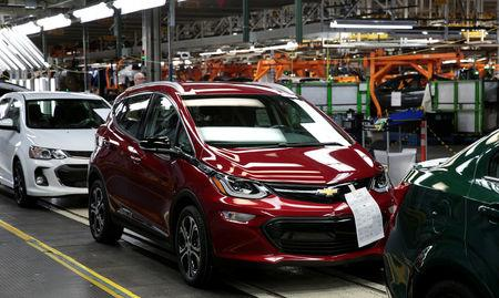 FILE PHOTO: A red 2018 Chevrolet Bolt EV vehicle is seen on the assembly line at General Motors Orion Assembly in Lake Orion, Michigan, U.S., March 19, 2018.  Photo taken March 19, 2018.   REUTERS/Rebecca Cook