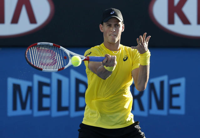 Vasek Pospisil of Canada hits a return to Samuel Groth of Australia during their men's singles match at the Australian Open 2014 tennis tournament in Melbourne January 13, 2014. REUTERS/Bobby Yip (AUSTRALIA - Tags: SPORT TENNIS)
