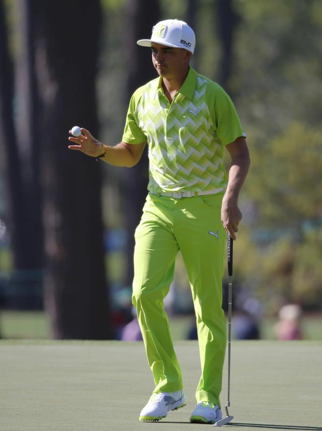 U.S. golfer Rickie Fowler acknowledges the gallery after sinking his putt on the third hole during the first round of the Masters golf tournament at the Augusta National Golf Club in Augusta, Georgia April 10, 2014. REUTERS/Mike Blake (UNITED STATES - Tags: SPORT GOLF)
