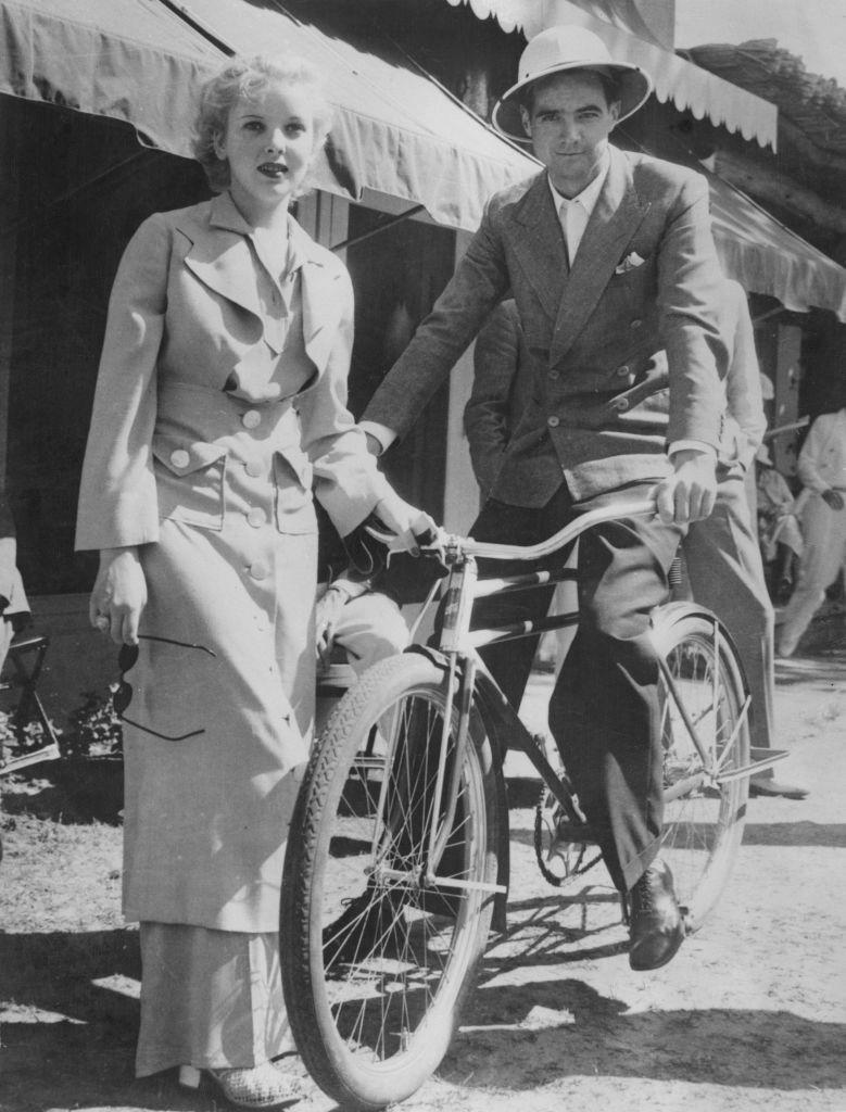 <p>The Hollywood director rides his bicycle while on vacation in Palm Springs, California in 1940 with British actress and director, Ida Lupino.</p>