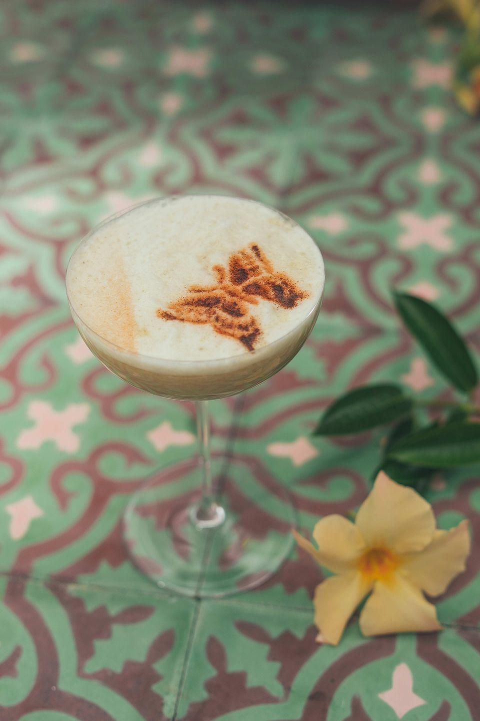 """<p><strong>Ingredients:</strong></p><p>1.5 oz Hennessy Black<br>.25 oz Ancho Reyes chili Liqueur<br>.25 oz Grand Marnier<br>.25 oz simple syrup<br>.5 oz Fresh Lime juice<br>1 egg white<br>2 dashes chocolate bitters</p><p><strong>Instructions:</strong></p><p>Add all ingredients to a shaker tin with ice, shake to chill, strain into a coupe glass and spray stencil image over the foam on top.</p><p><em>Created by <a href=""""https://www.hennessy.com/en-int"""" rel=""""nofollow noopener"""" target=""""_blank"""" data-ylk=""""slk:Hennessy"""" class=""""link rapid-noclick-resp"""">Hennessy</a></em><br></p>"""