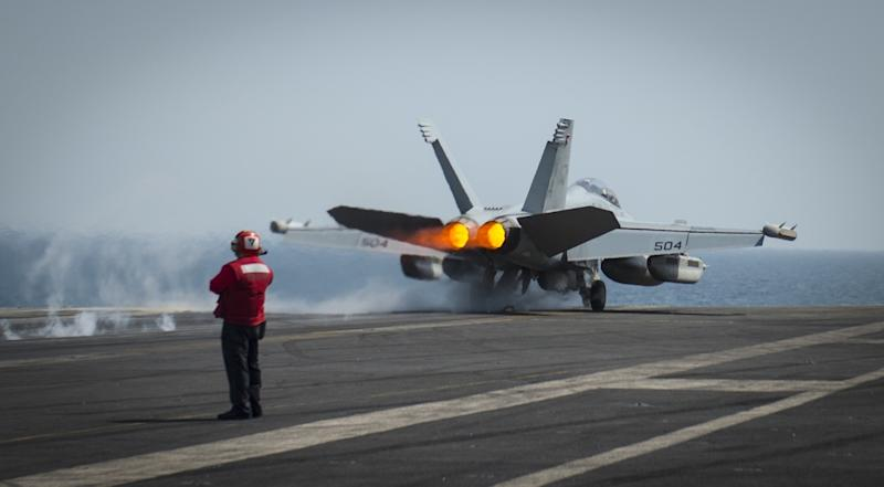 An EA-18G launches from the flight deck of the aircraft carrier USS Carl Vinson on March 19, 2015 as it takes part in strike operations in Iraq and Syria (AFP Photo/Scott Fenaroli)