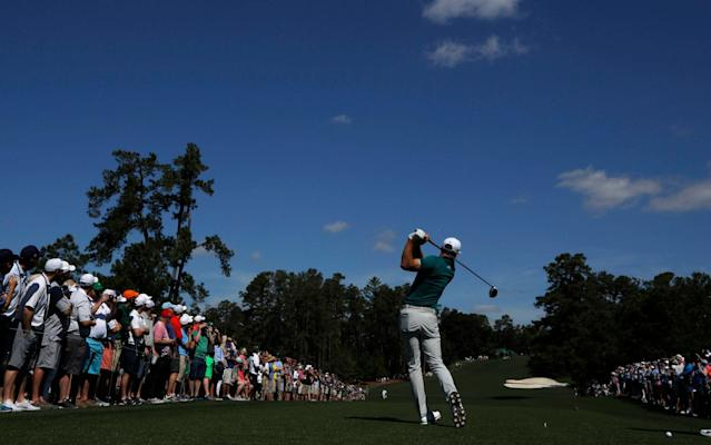 <span>Johnson drives down the par-five eighth at Augusta</span> <span>Credit: Reuters </span>