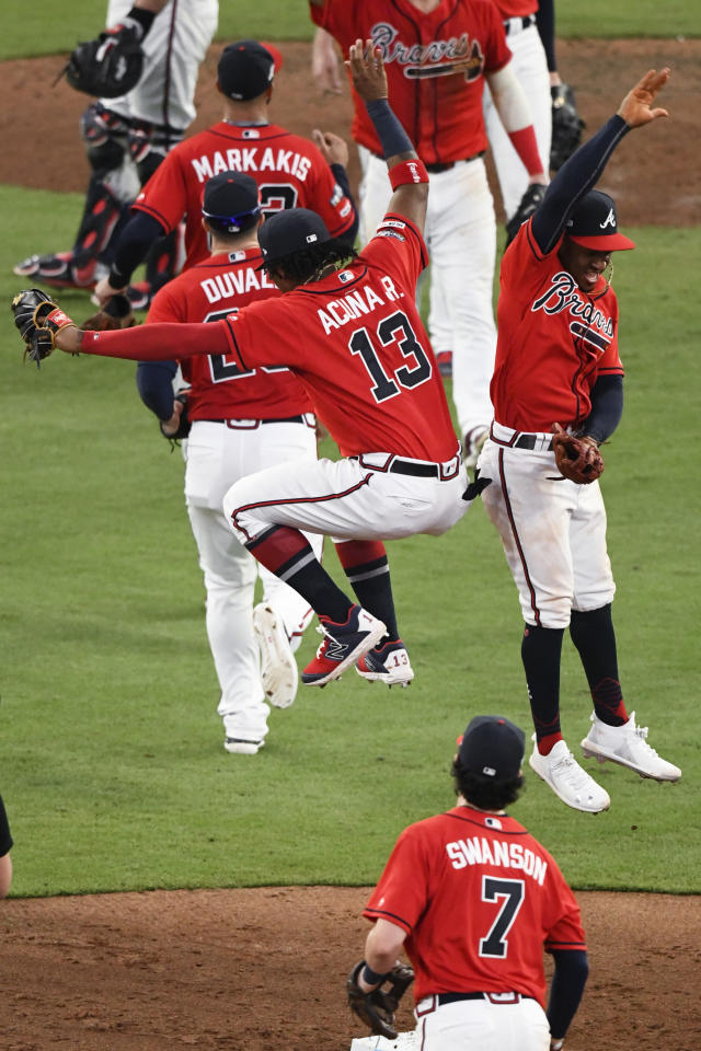 Atlanta Braves center fielder Ronald Acuna Jr. (13), celebrates with Atlanta Braves second baseman Ozzie Albies (1) after Game 2 of a best-of-five National League Division Series against the St. Louis Cardinals, Friday, Oct. 4, 2019, in Atlanta. The Atlanta Braves won 3-0. (AP Photo/Scott Cunningham)