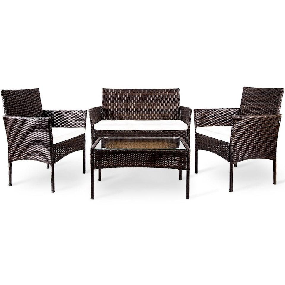 <p>This <span>Merax Outdoor Garden Rattan Patio Furniture Set</span> ($209) comes with a loveseat, two chairs, and a coffee table. It's perfect for larger outdoor balconies.</p>