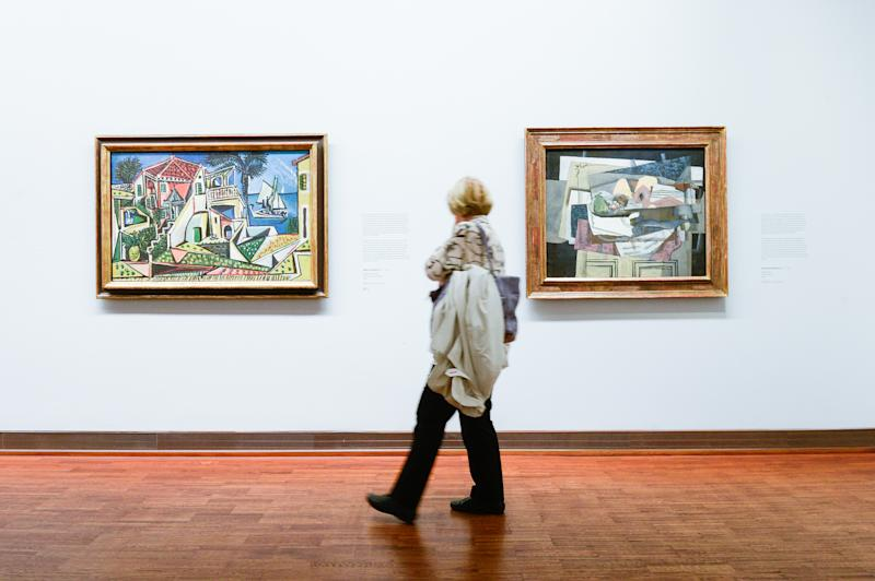 VIENNA, AUSTRIA - 2019/09/28: A woman walks by a painting of Spanish painter, Pablo Picasso during the exhibition. The Batliner Collection in Albertina Museum presents its extensive holdings of classical modernist paintings, which come from the Batliner Collection. The overview of the most interesting chapters of 130 years of art history is made possible by this permanent collection from various painters. (Photo by Omar Marques/SOPA Images/LightRocket via Getty Images)