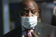 South African President Cyril Ramaphosa wears a face mask on a visit to a COVID-19 vaccination centre in Tembisa, South Africa, Thursday, July 29, 2021. Hitting its stride after a faltering start, South Africa's mass vaccination campaign gave jabs to 220,000 people a day last week and is accelerating toward the goal of 300,000 per day. With large deliveries of doses arriving and some vaccines being assembled here, South Africa appears on track to inoculate about 35 million of its 60 million people by the end of the year. (AP Photo)