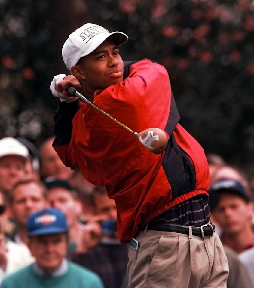 <p>Tiger Woods follows his tee shot on number two during practice for the Masters at the Augusta National Golf Club in Augusta, Ga., Tuesday, April 9, 1996. (AP Photo/Dave Martin) </p>