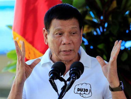 Philippine President Rodrigo Duterte gestures while delivering a speech during the inauguration of a drug abuse treatment and rehabilitation center inside the military headquarters in Fort Magsaysay, in the Nueva Ecija province