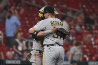 Pittsburgh Pirates catcher Michael Perez, left, celebrates with teammate Pittsburgh Pirates relief pitcher David Bednar after beating the St. Louis Cardinals in a baseball game Thursday, June 24, 2021, in St. Louis. (AP Photo/Joe Puetz)
