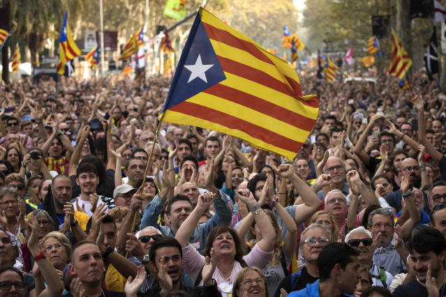 <p>People react as they celebrate the unilateral declaration of independence of Catalonia outside the Catalan Parliament, in Barcelona, Spain, Friday, Oct. 27, 2017. (Photo: Emilio Morenatti/AP) </p>