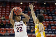Auburn guard Allen Flanigan (22) puts up a three pointer as Tennessee guard Jaden Springer (11) defends during the first half of an NCAA basketball game Saturday, Feb. 27, 2021, in Auburn, Ala. (AP Photo/Butch Dill)