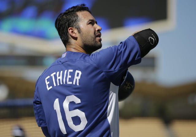 Los Angeles Dodgers center fielder Andre Ethier (16) looks toward the stands during warm-ups before Game 3 of the National League division baseball series Sunday, Oct. 6, 2013, in Los Angeles. (AP Photo/Jae C. Hong)