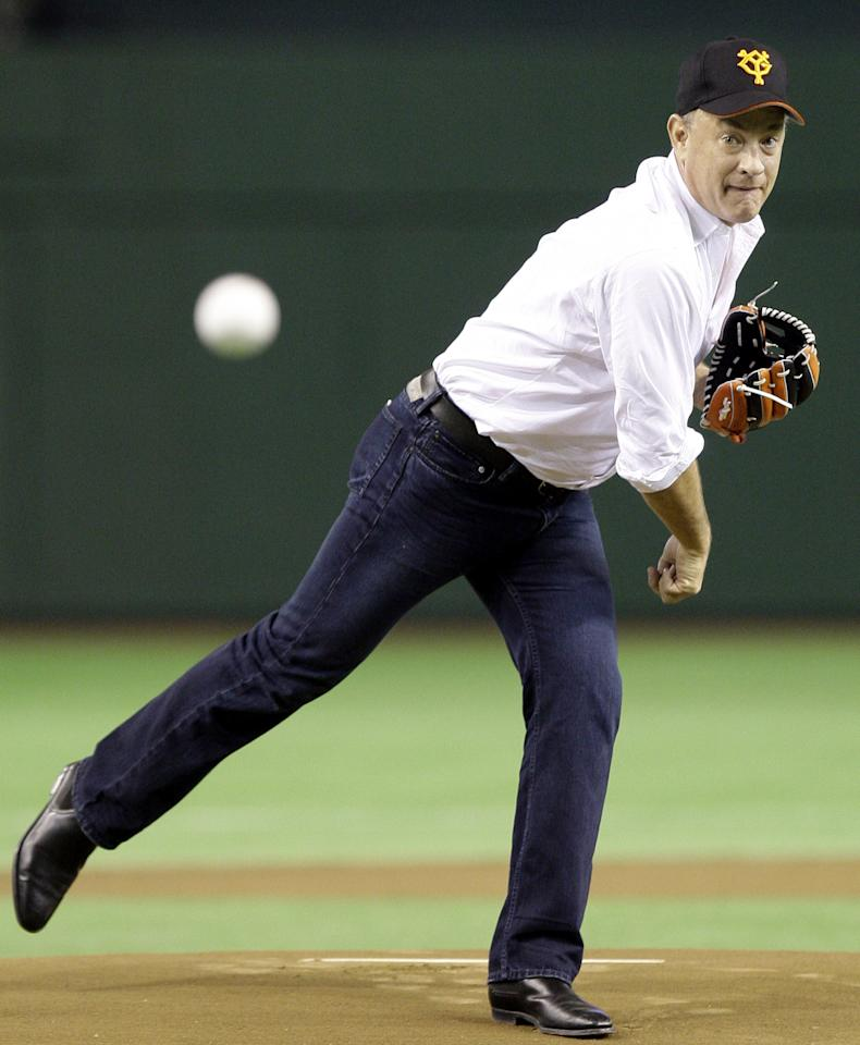 "U.S. actor Tom Hanks, wearing a baseball cap of the Yomiuri Giants, throws the first pitch before the start of Japan's professional baseball game between the Giants and the Chunichi Dragons at Tokyo Dome in Tokyo, Japan,  Friday, May 8, 2009. Keen baseball fan Hanks is in Tokyo to promote his latest film ""Angels & Demons"" which will be shown around the world on May 15.  (AP Photo/Koji Sasahara)"