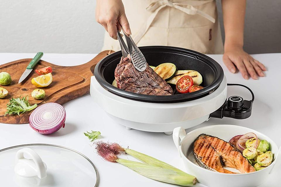 """Youcan practically replace your stove with this because it can be used to grill, slow-cook, steam, simmer and serve. It features a deep, large-capacity 3-quart pot and a large 10-inch grill. The non-electric parts are dishwasher-safe.<br /><br /><strong>Promising review:</strong>""""Bought this to replace my stove. I can grill in it, fry fish, make soups, stews, and omelets, steam vegetables, and bake in it. I love it. It's easy on the electric bill and doesn't heat up the house."""" — <a href=""""https://www.amazon.com/gp/customer-reviews/R30JUON0JQ9VRH?&linkCode=ll2&tag=huffpost-bfsyndication-20&linkId=6b36fd8a01b12976b6dd9d0bf64d90f9&language=en_US&ref_=as_li_ss_tl"""" target=""""_blank"""" rel=""""noopener noreferrer"""">William Thomas</a><br /><br /><strong><a href=""""https://www.amazon.com/dp/B00024JQ3Q?&linkCode=ll1&tag=huffpost-bfsyndication-20&linkId=d896c1bfdbf911552927d7336c047f4e&language=en_US&ref_=as_li_ss_tl"""" target=""""_blank"""" rel=""""noopener noreferrer"""">Get it from Amazon for $29.90+ (available in two colors).</a></strong>"""