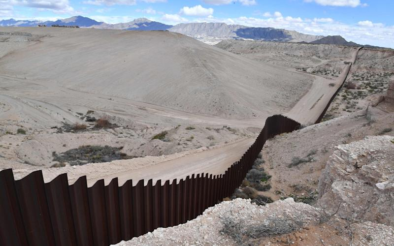 The metal fence between Mexico and the United States is seen in Puerto Anapra, Chihuahua state, on February 19, 2017.  - AFP or licensors