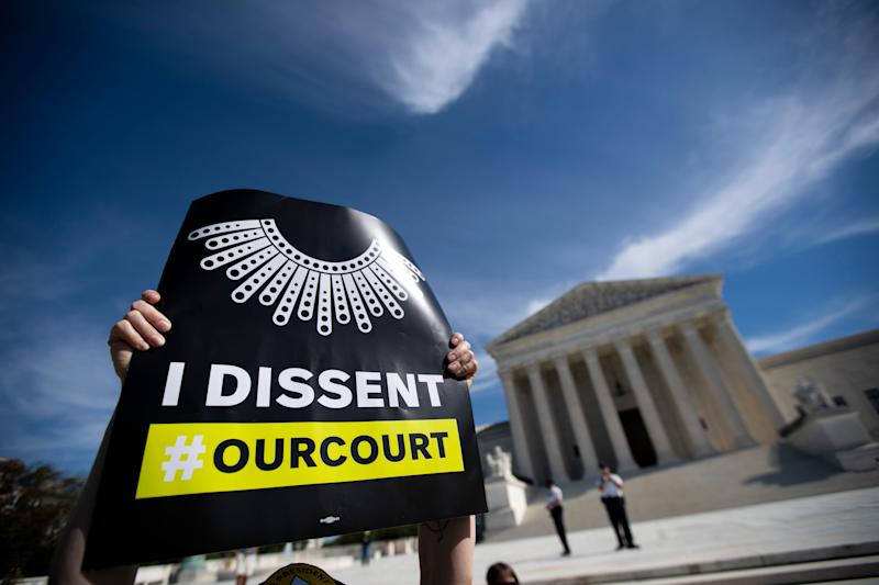 Protesters opposed to the confirmation of President Donald Trump's Supreme Court nominee Amy Coney Barrett, rally at the Supreme Court on Capitol Hill, in Washington, Wednesday, Oct. 14, 2020. (AP Photo/Jose Luis Magana) ORG XMIT: DCJL115