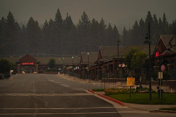 A shopping mall sits empty after people were ordered to evacuate the area due to the Caldor fire.