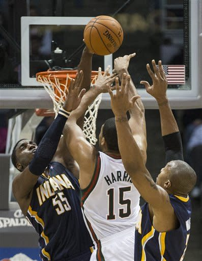 Indiana Pacers' Roy Hibbert, left, blocks the shot by Milwaukee Bucks' Tobias Harris (15) during the second half of an NBA basketball game on Wednesday, Nov. 14, 2012, in Milwaukee. (AP Photo/Tom Lynn)