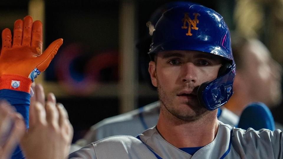 Pete Alonso high-fiving in Mets dugout close shot of his face