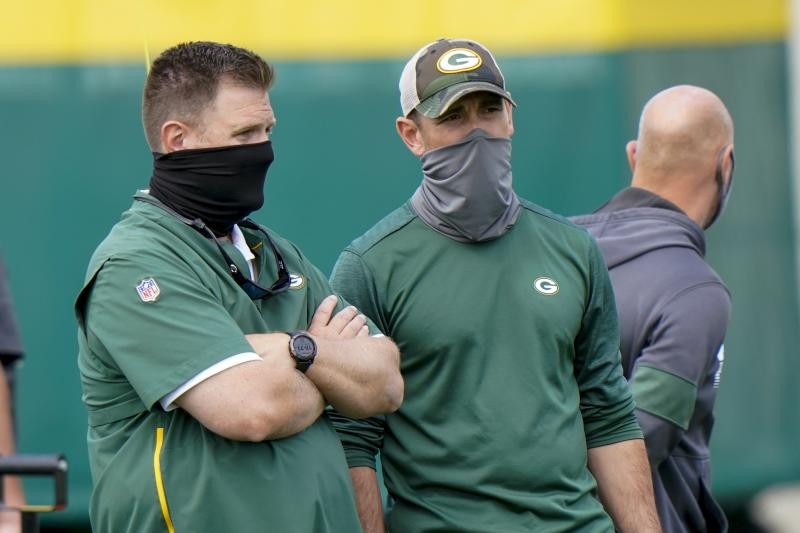 Green Bay Packers head coach Matt LaFleur talks to general manager Brian Gutekunst during NFL football training camp Saturday, Aug. 15, 2020, in Green Bay, Wis. (AP Photo/Morry Gash)