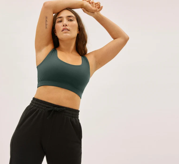 The Perform Bra in Pine. Image via Everlane