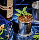 """<p><em>There's no substituting bourbon in a true Mint Julep. This cocktail is Kentucky charm—sweet and sharp—through and through. Take the time to achieve perfection with a pre-chilled mug, cracked ice, and small, tender mint leaves. Bet on a horse while you're at it.</em><br></p><p><strong>Ingredients<br></strong>• 3 oz. bourbon<br>• 5-6 mint leaves<br>• 1 tsp. sugar</p><p><strong>Directions<br></strong>1. Place mint leaves in the bottom of a pre-chilled, dry pewter cup. Add sugar and crush slightly with a muddler. <br>2. Pack glass with finely cracked ice, then pour a generous 3 ounces of Kentucky bourbon over the ice. <br>3. Stir briskly until the glass frosts. <br>4. Add more ice and stir again before serving. Stick a few sprigs of mint into the ice to get the aroma. <br><br><a class=""""link rapid-noclick-resp"""" href=""""https://www.esquire.com/food-drink/drinks/recipes/a3827/mint-julep-drink-recipe/"""" rel=""""nofollow noopener"""" target=""""_blank"""" data-ylk=""""slk:Read More"""">Read More</a><br></p>"""
