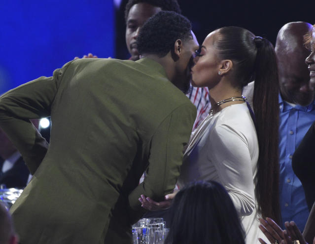 Rece Mitchell, right, congratulates NBA player Lou Williams, of the Los Angeles Clippers, before he walks on stage to accept the NBA sixth man award at the NBA Awards on Monday, June 24, 2019, at the Barker Hangar in Santa Monica, Calif. (Photo by Richard Shotwell/Invision/AP)