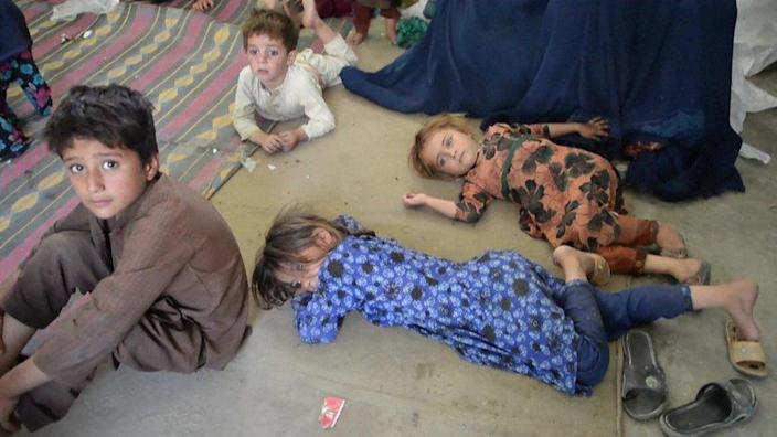 Weary children rest on the floor of a school in Asadabad, Kunar province.