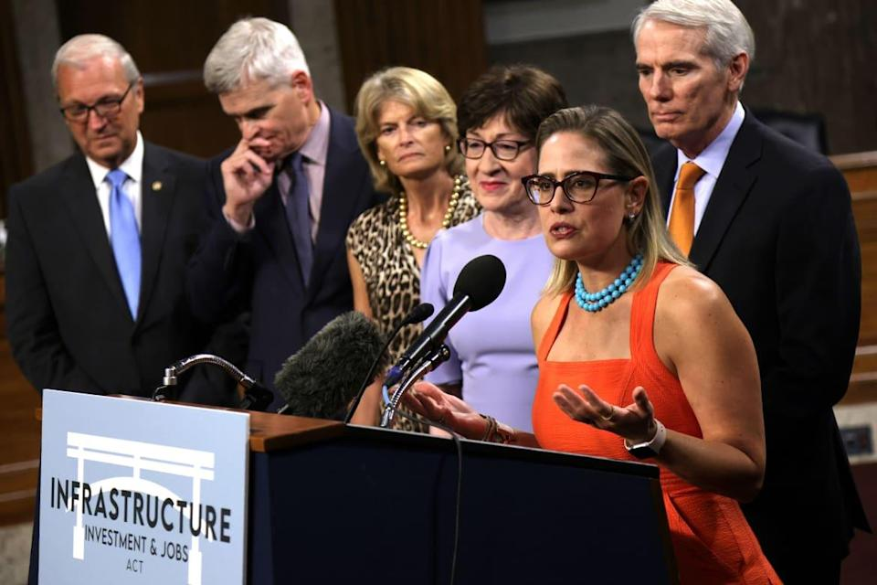 """<div class=""""inline-image__caption""""><p>Sen. Sinema speaks to the media after a procedural vote for the infrastructure framework on July 28, 2021 in Washington, DC.</p></div> <div class=""""inline-image__credit"""">Alex Wong/Getty Images</div>"""