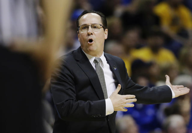 Wichita State head coach Gregg Marshall appeals to an official against Kentucky during the second half of a third-round game of the NCAA college basketball tournament Sunday, March 23, 2014, in St. Louis. (AP Photo/Jeff Roberson)