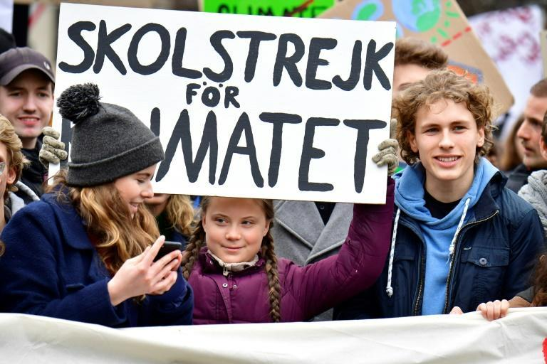 Jakob Blasel (R) in 2019, campaigning with Thunberg at a Fridays for Future demo in Berlin (AFP/Tobias SCHWARZ)