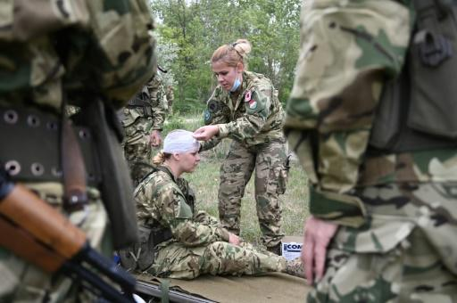 All in a day's work: new recruits are put though their paces in training exercises