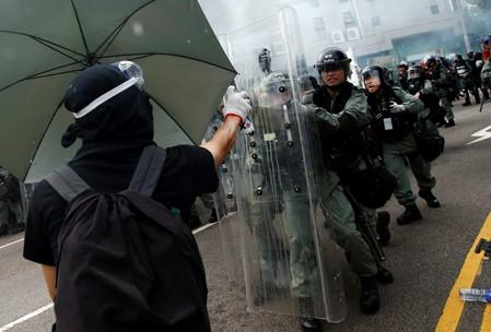 Demonstrators clash with police during a protest against the Yuen Long attacks in Yuen Long, New Territories, Hong Kong