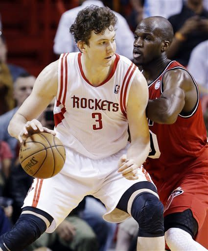 Houston Rockets center Omer Asik (3), of Turkey, drives against Miami Heat center Joel Anthony during the first half of an NBA basketball game, Wednesday, Feb. 6, 2013, in Miami. (AP Photo/Wilfredo Lee)