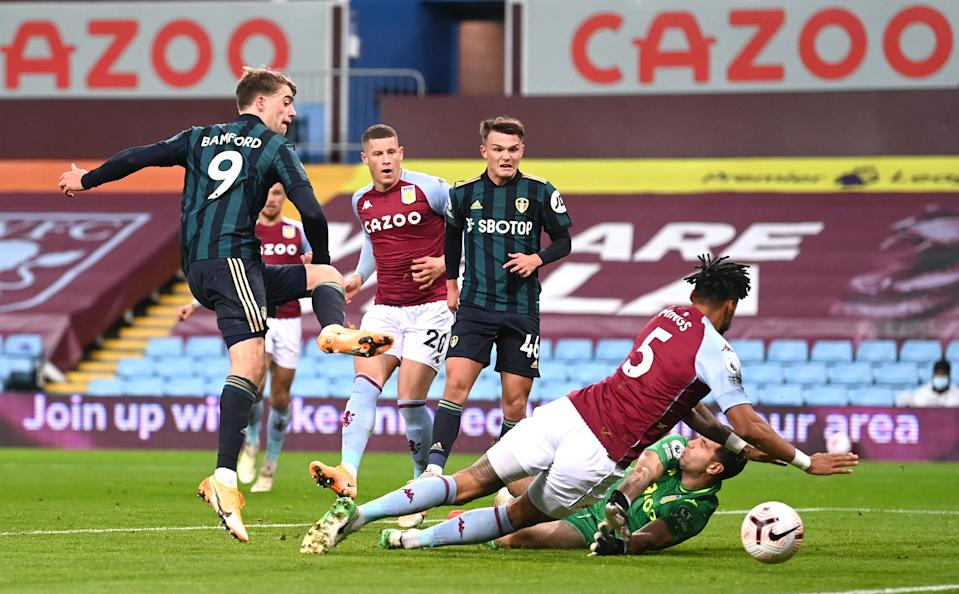 Leeds United's Patrick Bamford (left) scores his side's first goal of the game during the Premier League match at Villa Park, Birmingham. (Photo by Laurence Griffiths/PA Images via Getty Images)