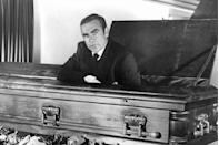 <p>Sean Connery sitting in a coffin in a scene from Diamonds Are Forever.</p>