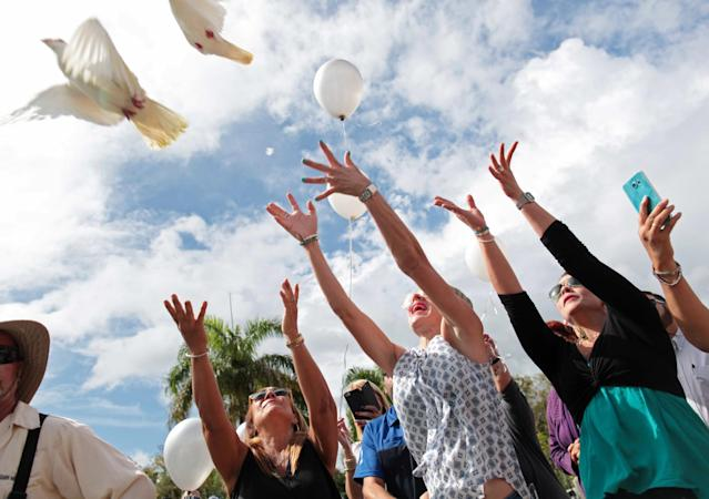 <p>Friends and family release doves and balloons during the funeral for Franky Jimmy De Jesus Velazquez, one of the victims of the shooting at the Pulse night club in Orlando, in his hometown of Caguas, Puerto Rico, June 21, 2016. (REUTERS/Alvin Baez) </p>