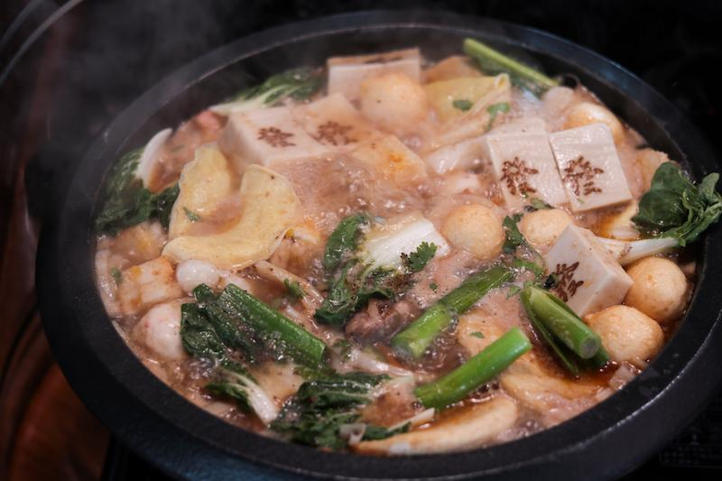 A stonepot full of steamboat ingredients from Feima Taiwan Stone Hotpot