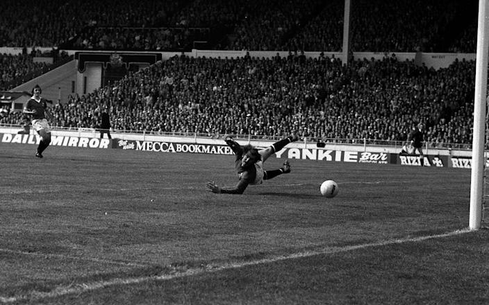 Manchester United goalkeeper Alex Stepney can only look in vain as Stokes' fearsome shot heads for the back of the net - PA