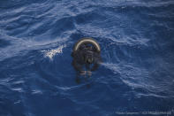 The body of one of the victims of the shipwreck of a dinghy which was supposedly carrying over 100 migrants, is seen floating in the Mediterranean Sea northeast of the Libyan capital, Tripoli, Thursday, April 22, 2021. SOS Mediterranee, which operates the rescue vessel Ocean Viking, said late Thursday that the wreck of a rubber boat, which was initially carrying around 130 people, was spotted in the Mediterranean Sea. The aid vessel did not find any survivors, but could see at least ten bodies near the wreck, the group added in a statement. (Flavio Gasperini/SOS Mediterranee via AP)