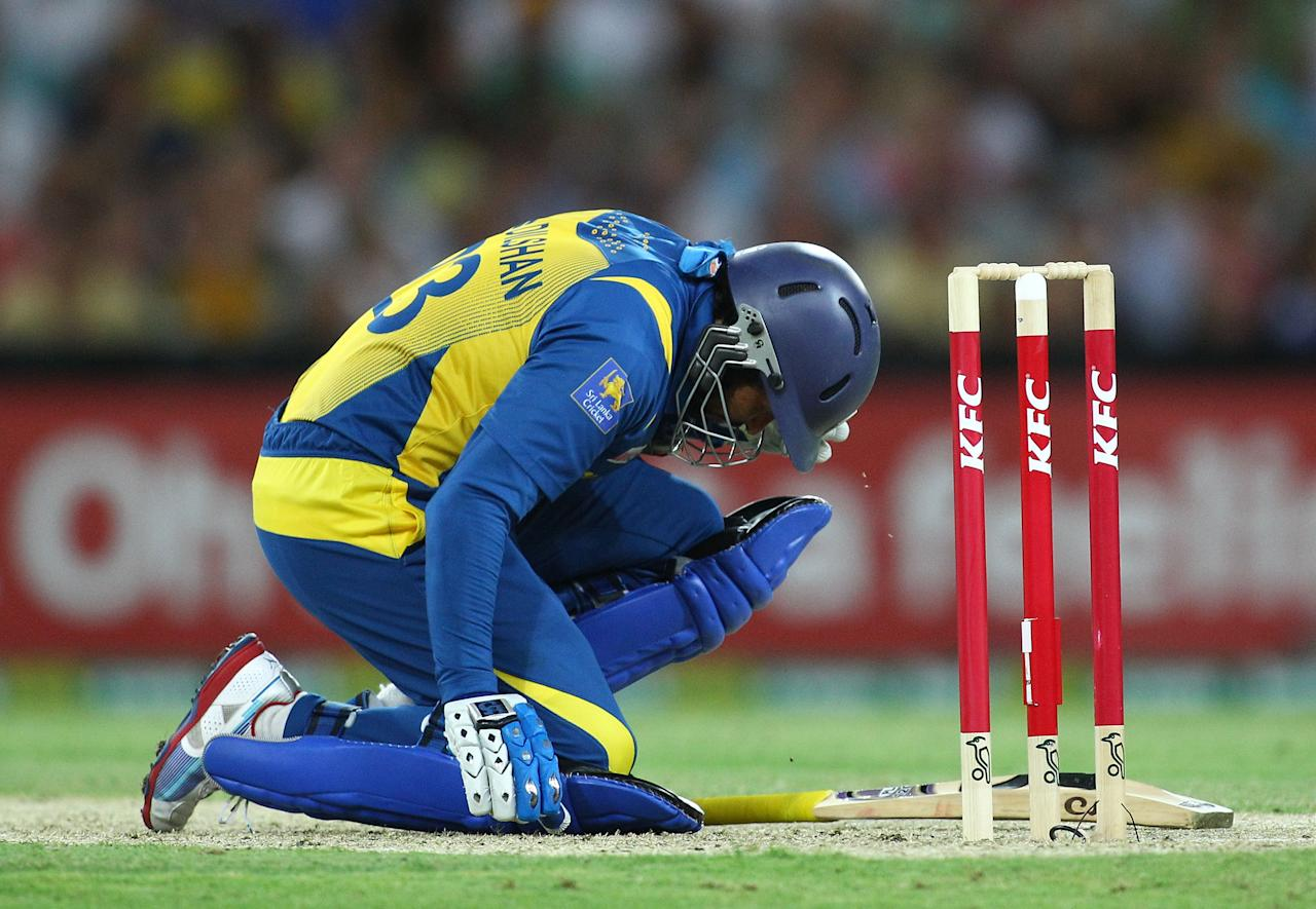 SYDNEY, AUSTRALIA - JANUARY 26:  Tillakaratne Dilshan of Sri Lanka is felled by a Ben Laughlin bouncer during game one of the Twenty20 international match between Australia and Sri Lanka at ANZ Stadium on January 26, 2013 in Sydney, Australia.  (Photo by Don Arnold/Getty Images)