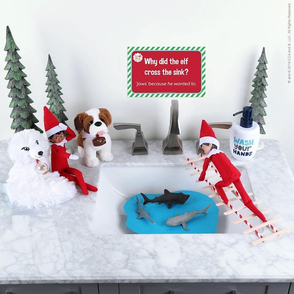 """<p>""""Why did the elf cross the sink?"""" reads the cute sign over this adventure. """"'Jaws' because he wanted to!""""</p><p><strong>Get the tutorial at <a href=""""https://elfontheshelf.com/elf-ideas/bridge-to-safety/"""" rel=""""nofollow noopener"""" target=""""_blank"""" data-ylk=""""slk:Elf on the Shelf"""" class=""""link rapid-noclick-resp"""">Elf on the Shelf</a>.</strong></p><p><strong><a class=""""link rapid-noclick-resp"""" href=""""https://go.redirectingat.com?id=74968X1596630&url=https%3A%2F%2Fwww.walmart.com%2Fsearch%2F%3Fquery%3Delf%2Bon%2Bthe%2Bshelf&sref=https%3A%2F%2Fwww.thepioneerwoman.com%2Fholidays-celebrations%2Fg34080491%2Ffunny-elf-on-the-shelf-ideas%2F"""" rel=""""nofollow noopener"""" target=""""_blank"""" data-ylk=""""slk:SHOP ELF ON THE SHELF"""">SHOP ELF ON THE SHELF</a><br></strong></p>"""
