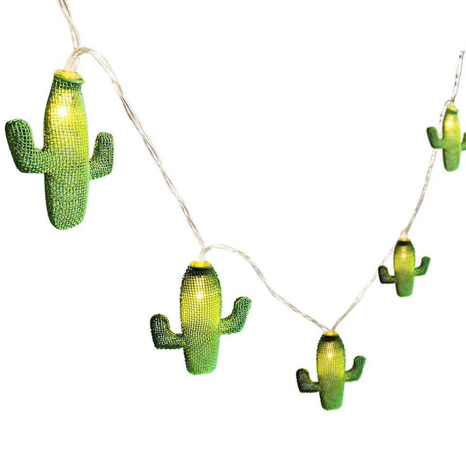 """<h2>Cactus String Lights<br></h2><br>Normal string lights read cute. These read, """"I'm on a dusty dude ranch, cracking open a cold one as the coyotes howl and the stars shine.""""<br><br><strong>Twinkle Star</strong> Cactus String Lights, $, available at <a href=""""https://www.amazon.com/Twinkle-Star-Operated-Christmas-Decoration/dp/B07GWN7X13"""" rel=""""nofollow noopener"""" target=""""_blank"""" data-ylk=""""slk:Amazon"""" class=""""link rapid-noclick-resp"""">Amazon</a>"""