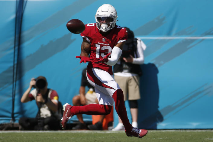 Arizona Cardinals wide receiver Christian Kirk (13) makes a reception against the Jacksonville Jaguars during the second half of an NFL football game, Sunday, Sept. 26, 2021, in Jacksonville, Fla. (AP Photo/Stephen B. Morton)