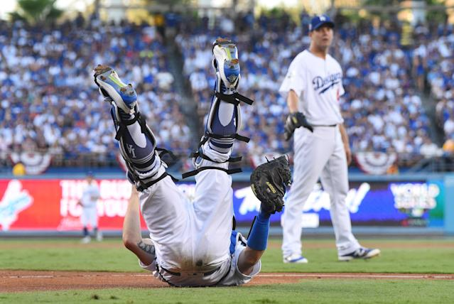 <p>Los Angeles Dodgers catcher Austin Barnes catches a pop foul hit by Houston Astros third baseman Alex Bregman (not pictured) in the first inning in game two of the 2017 World Series at Dodger Stadium. Mandatory Credit: Jayne Kamin-Oncea-USA TODAY Sports </p>