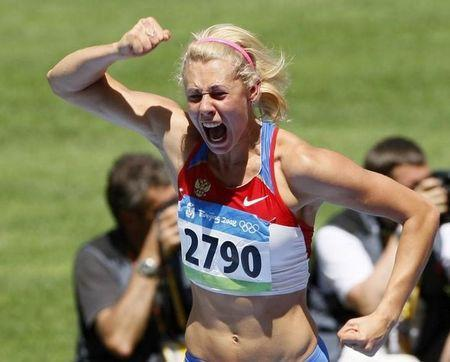 Tatiana Chernova of Russia reacts during her women's heptathlon high jump qualifying round at the National Stadium during the Beijing 2008 Olympic Games August 15, 2008. REUTERS/Lucy Nicholson